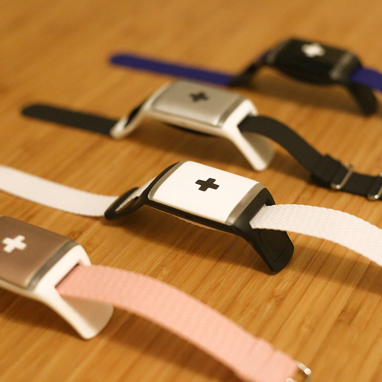 A close-up of CareBand bracelets with wearable sensors to monitor movement and daily activity.