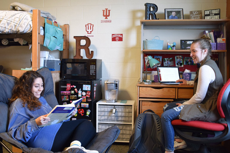 Two students who are part of the SICE LLC study together in their dorm room.
