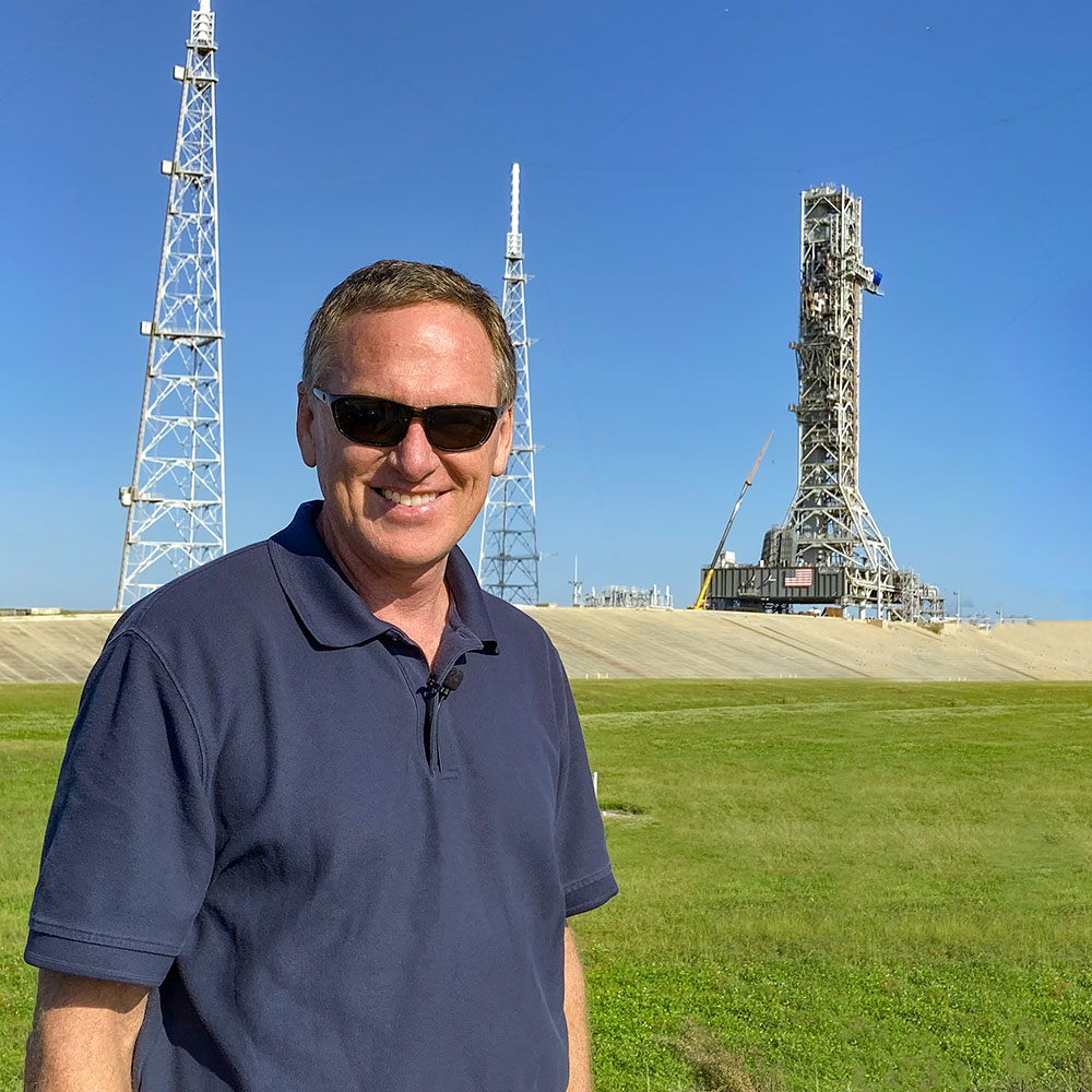 Professor Mike Bolger standing in from of NASA launch pads