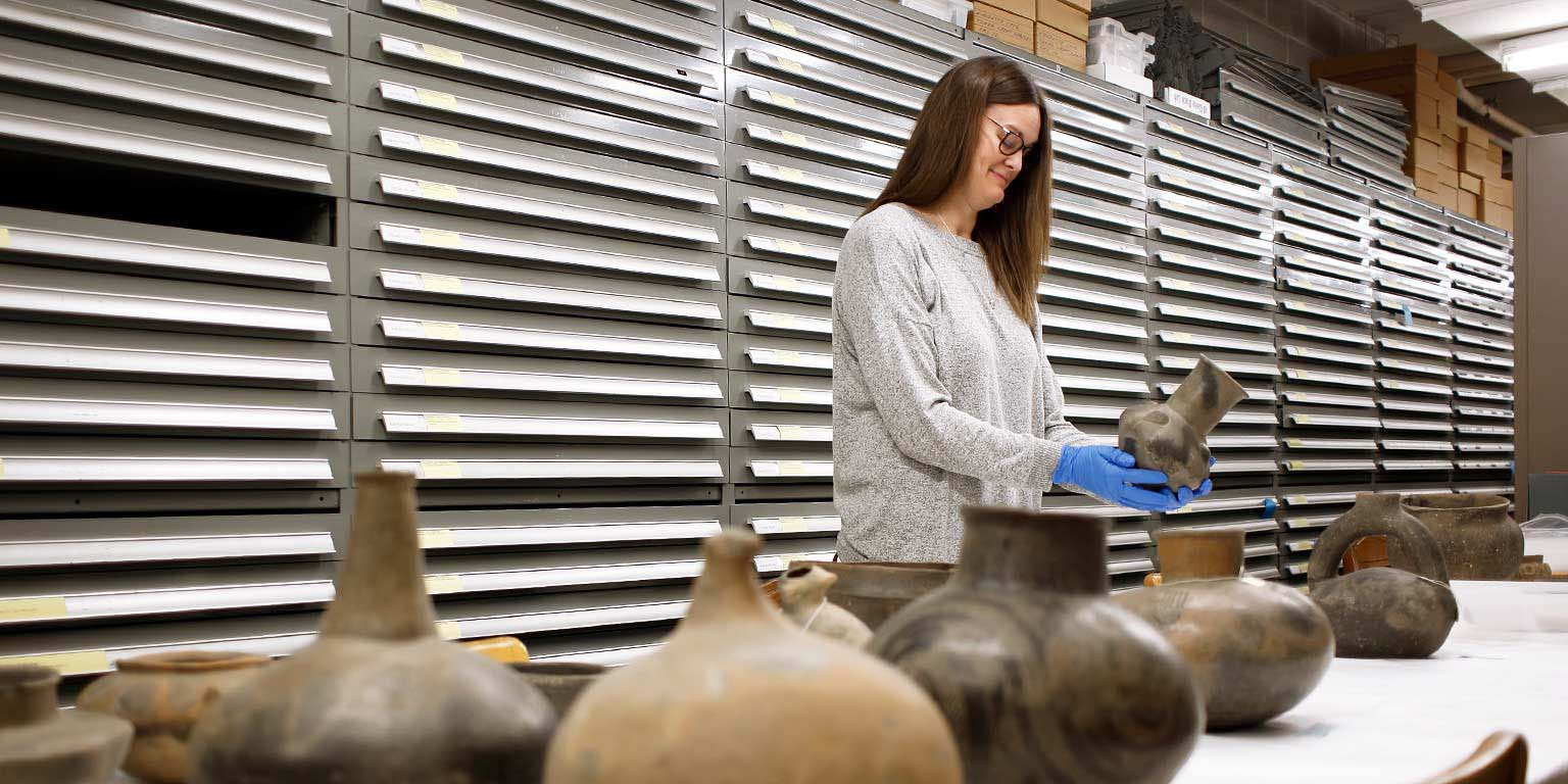 A researcher examines artifacts in the Glenn A. Black Laboratory of Archaeology.